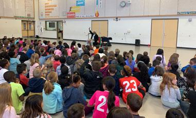 Oba William King telling stories in the Denton area schools.